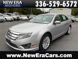 Picture of a 2012 FORD FUSION HYBRID 42+mpg NICE!